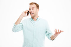 Happy handsome young businessman talking on mobile phone Royalty Free Stock Images