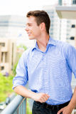 Happy, handsome young man, enjoying his outside balcony Stock Images