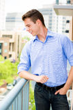 Happy, handsome young man, enjoying his outside balcony Stock Photography