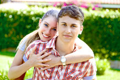 Happy handsome young man hugged by cute girlfriend Royalty Free Stock Image
