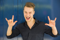 Happy handsome young man screaming Stock Photography