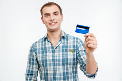 Happy handsome young man showing credit card Stock Photos