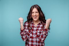 Happy handsome young woman posing isolated over the blue background. stock photography
