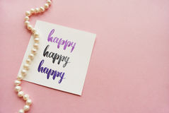 `Happy` handwritten with watercolor in calligraphy style Stock Photo