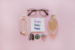`Happy` handwritten with watercolor in calligraphy style. Women`s fashion accessories. Flat lay Stock Photography