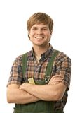 Happy handyman with arms crossed Royalty Free Stock Photo