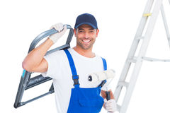 Happy handyman with chair and paint roller on white background Stock Photo