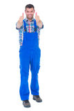 Happy handyman in coveralls gesturing thumbs up Royalty Free Stock Photo