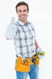 Happy handyman gesturing thumbs up. Portrait of happy handyman gesturing thumbs up over white background Royalty Free Stock Image