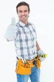 Happy handyman gesturing thumbs up Royalty Free Stock Image
