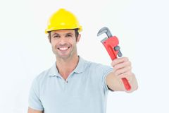 Happy handyman holding monkey wrench Stock Images