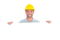 Happy handyman holding placard on white background Royalty Free Stock Photo
