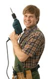 Happy handyman posing with power drill. Smiling. Isolated on white Stock Photo
