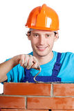 Happy handyman with trowel and brick Royalty Free Stock Images