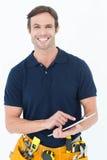 Happy handyman using digital table Stock Image