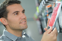 Happy hansome man buying in shopping mall Stock Images
