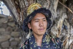 Happy and hansome young man in tradtional dress. In spiti, india Stock Images