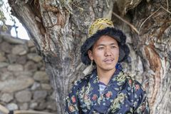 Happy and hansome young man in tradtional dress. In spiti, india Stock Image