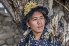 Happy and hansome young man in tradtional dress. In spiti, india Stock Photo