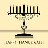 Happy Hanukkah. Abstract colorful illustration with black menorah with nine candles and the text Happy Hanukkah written under the candle holder Royalty Free Stock Photo