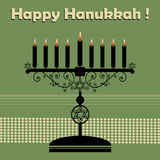 Happy Hanukkah. Abstract colorful background with jewish menorah having nine candles and the text Happy Hanukkah written above the candle holder Stock Photo