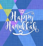 Happy Hanukkah calligraphy on background of abstract colorful star of David. For greeting cards, banners, posters Stock Photo