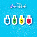 Happy hanukkah with dreidels - spinning top. Royalty Free Stock Images
