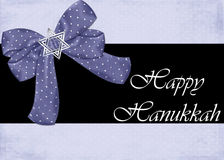 Happy Hanukkah Greeting Card. Designed with a pretty blue bow topped with a silver star of david vector illustration