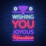 Happy Hanukkah, a greeting card in a neon style. Vector illustration. Neon luminous text on the subject of Chanukah. Bright banner, luminous festive sign Stock Photos