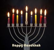 Happy Hanukkah jewish holiday. Menorah traditional candelabra. With burning candles against black background Royalty Free Stock Image
