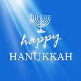 Happy Hanukkah lettering on blue background Royalty Free Stock Photo