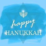 Happy Hanukkah lettering on blue background Royalty Free Stock Image