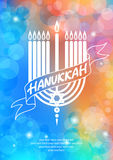 Happy Hanukkah lettering on blur bokeh background Royalty Free Stock Images