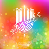 Happy Hanukkah lettering on blur bokeh background. Royalty Free Stock Photography