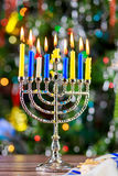Happy Hanukkah. Low key image of jewish holiday with menorah the night view out focus Stock Images