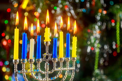 Happy Hanukkah. Low key image of jewish holiday with menorah the night view out focus Royalty Free Stock Photos