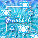 Happy Hanukkah with origami blue Magen David stars. Happy Hanukkah with origami Magen David stars. Papercraft jewish holiday simbol on blue background with Stock Photo