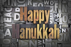 Happy Hanukkah. Written in vintage letterpress type Royalty Free Stock Image