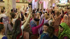 Happy Hare Krishna followers dance in the Temple stock video