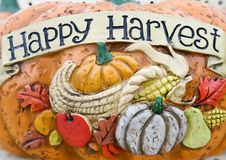 Happy harvest words on a pumpkin  craft Stock Images