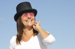 Happy hat wearing woman sky background Royalty Free Stock Photo