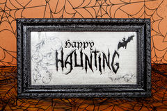 Happy Haunting. A happy haunting sign for the Halloween holiday Royalty Free Stock Images