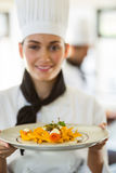 Happy head chef presenting her food Stock Photography