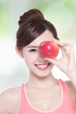 Happy health woman show apple Royalty Free Stock Photography