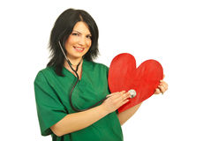 Happy health worker checkup heart Royalty Free Stock Photography