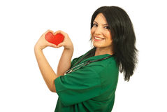 Happy health worker with heart shape Stock Image