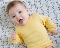 Happy and healthy 4 months baby girl lying Stock Image