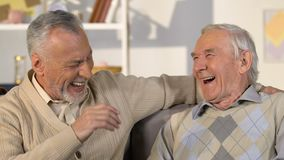 Happy healthy aged men talking laughing closeup, positive pensioners, good mood. Stock footage stock video
