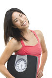 Happy and healthy. Beautiful Asian woman holding a weight scale Royalty Free Stock Image