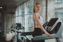 Beautiful young fitness woman working out at the gym royalty free stock photo